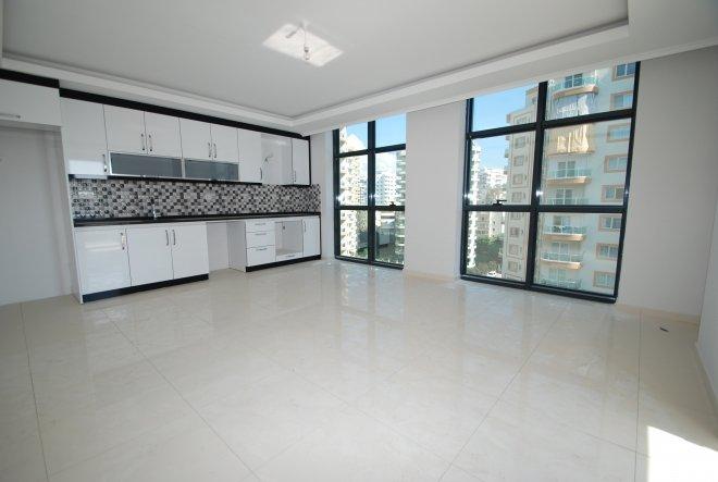 Новая стильная квартира 2+1 в Махмутларе по приемлемой цене